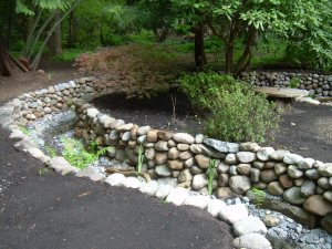 The creek wall is made entirely from rock on the owner's property