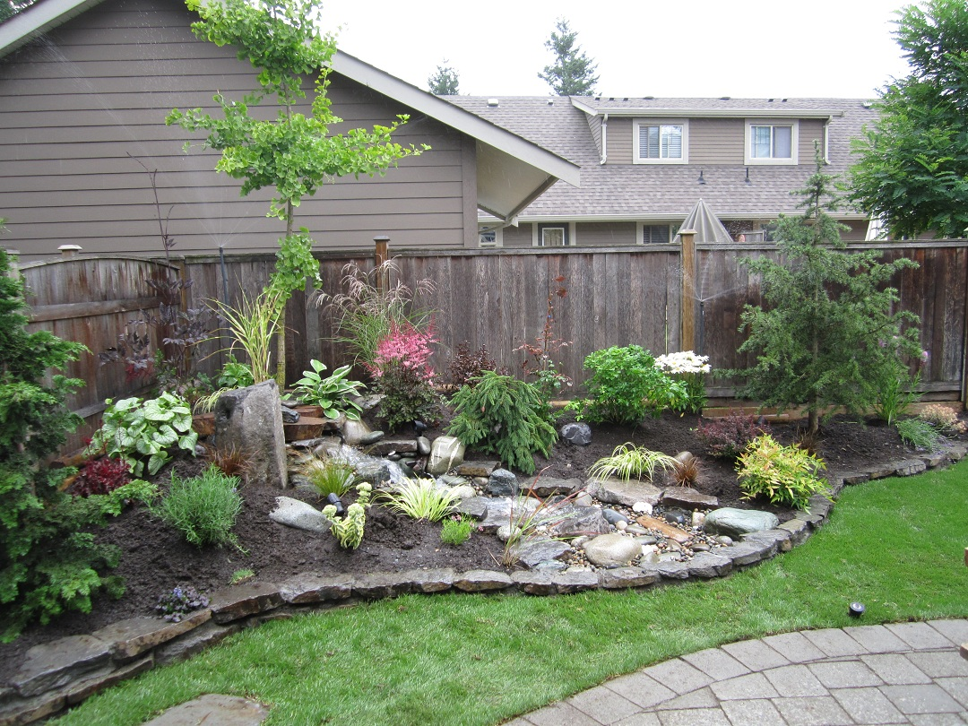 Small backyard makeover srp enterprises 39 weblog for Grass garden ideas